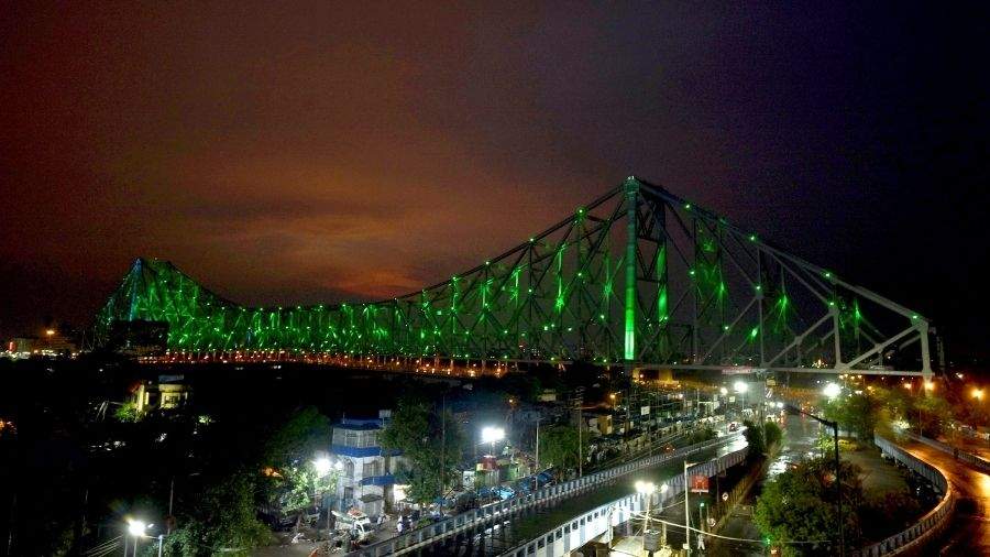Howrah Bridge in Calcutta dons a green look on the occasion of World Environment Day on Saturday.