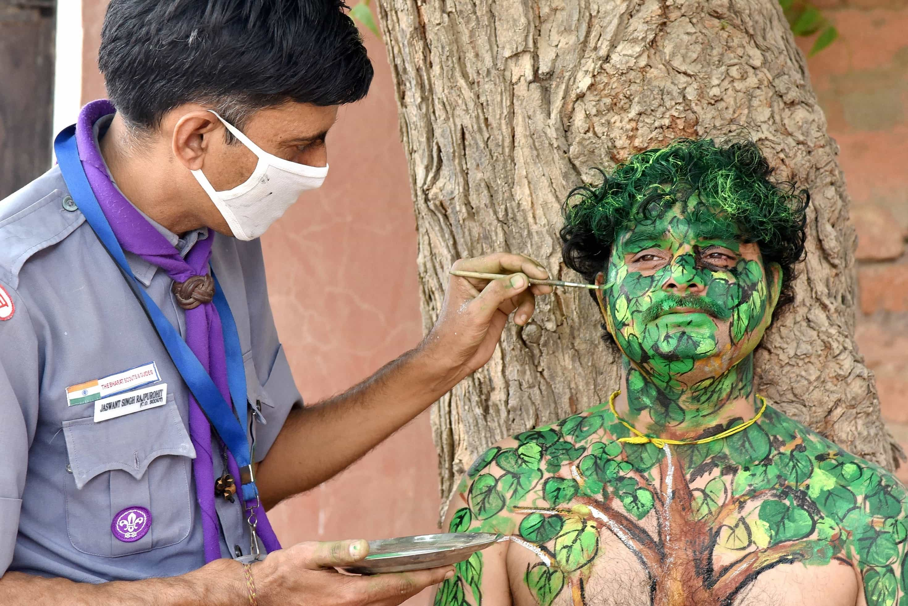 An activist paints himself on World Environment Day in  to raise awareness about the importance of saving nature, in Bikaner, on Saturday.
