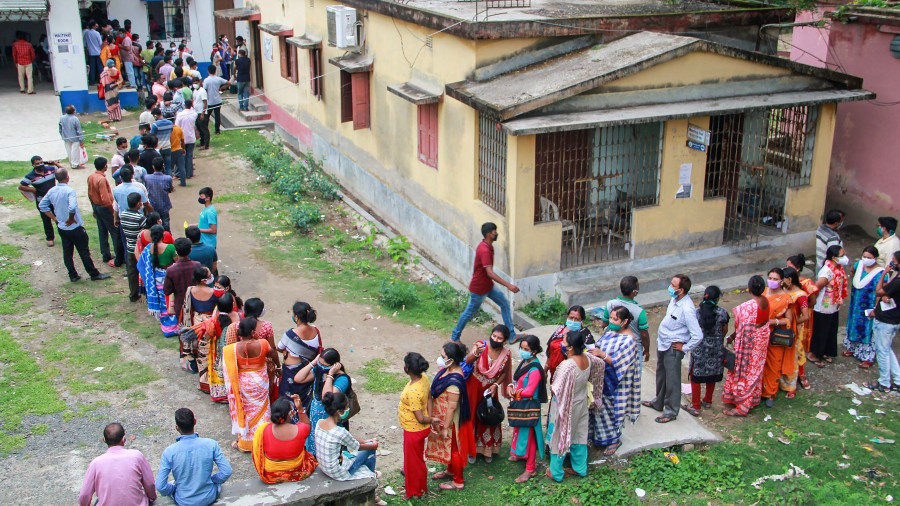 People line up for a shot of Covid-19 vaccine at a government hospital in Bolpur, Birbhum district, West Bengal