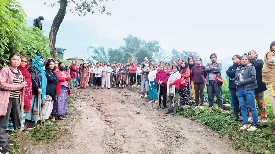 Protesters block the road to the Assam Rifles post on Saturday in protest against the killing of the youth on  Friday night in Manipur's Kangpokpi district