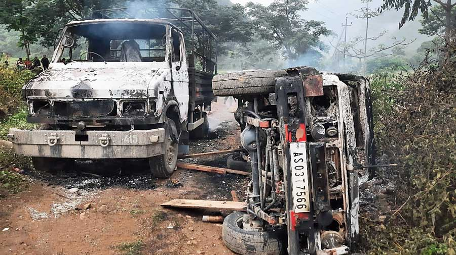 The two vehicles burnt down in protest against the killing of the youth by Assam Rifles personnel