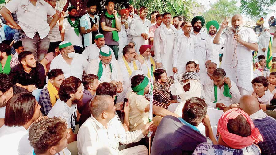 Rakesh Tikait and others at the protest at Tohana in Fatehabad district, Haryana,  on Sunday.