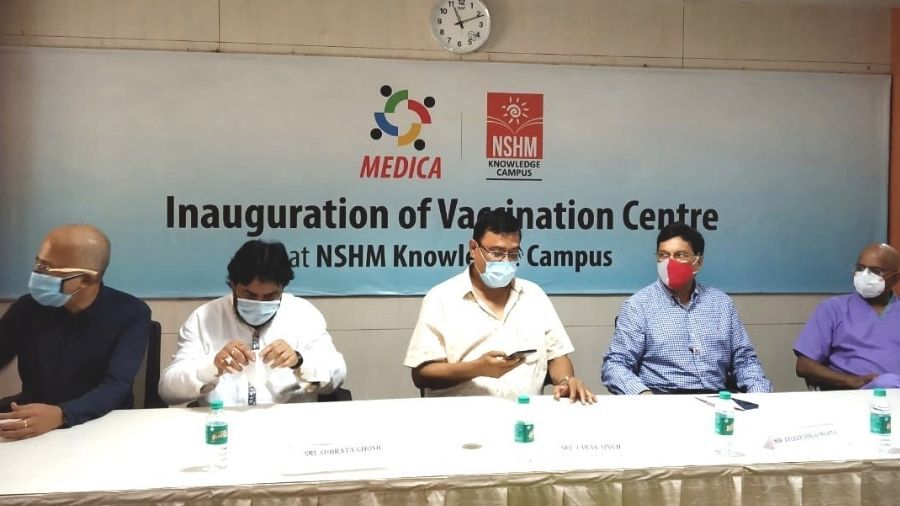 Members of NSHM Knowledge Campus and Medica Superspeciality Hospitals launch the vaccine drive on Monday.