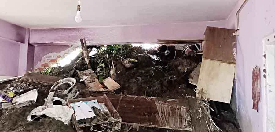 A building hit by a landslide at Sichey in Gangtok on Wednesday