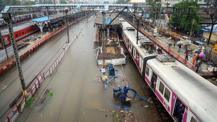 Waterlogged railway tracks at a station after heavy rains, in Thane on Wednesday.