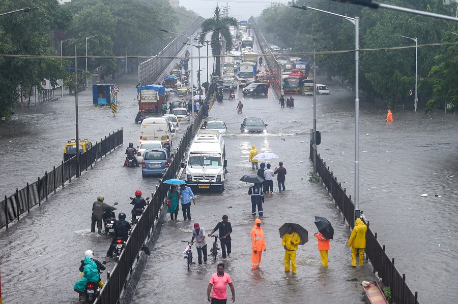 Vehicles wade through a waterlogged road at Kings Circle in Mumbai on Wednesday.