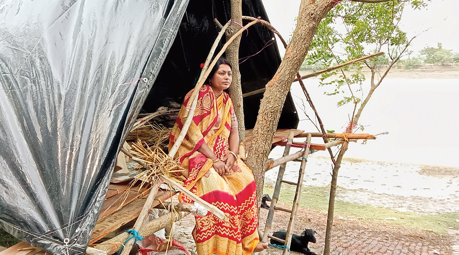 Homemaker Suchitra Mandal waits in a tent on the banks of Goureswar river in Hingalganj on Thursday.