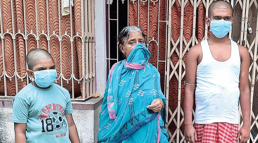 Soumit (left) and Souvik with their grandmother Sandhya Saha.