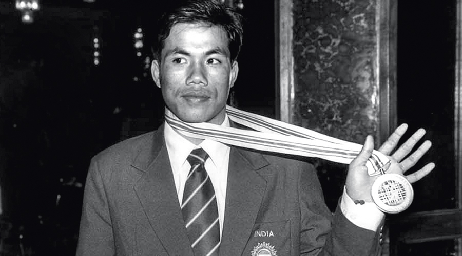 In a picture from December 24, 1998, Dingko Singh displays his Asian Games gold medal.