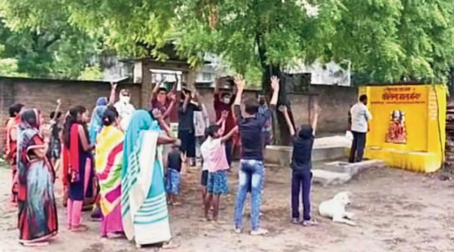 Villagers pray at the 'Corona Mata' temple  at a village in Pratapgarh district in  Uttar Pradesh on Friday.