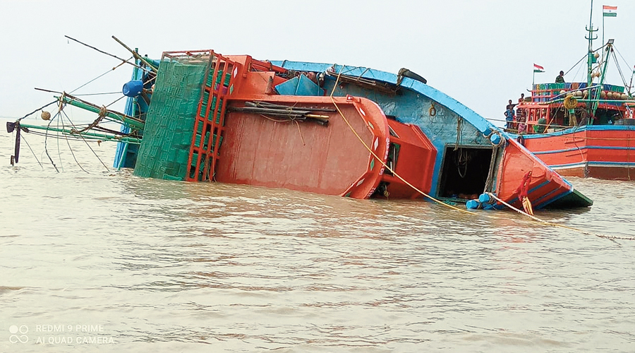 The trawler for hilsa fishing that overturned late on Saturday night in the Hooghly, off Nandigram in East Midnapore, prompting NDRF personnel to search for the three missing fishermen on Sunday.
