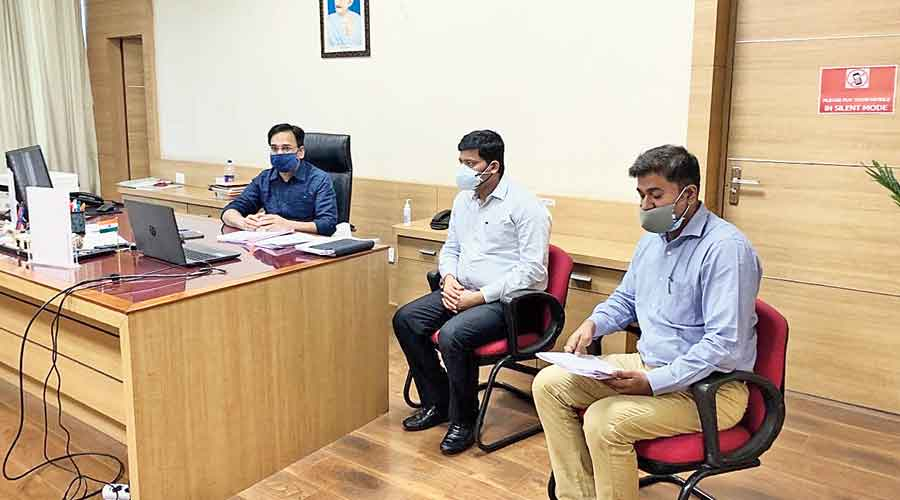 Urban development secretary Vinay Choubey (extreme left in blue mask on the laptop) at the meeting on Friday.