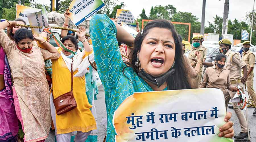 Congress workers protest against the Ayodhya  land deal in Lucknow  on Monday