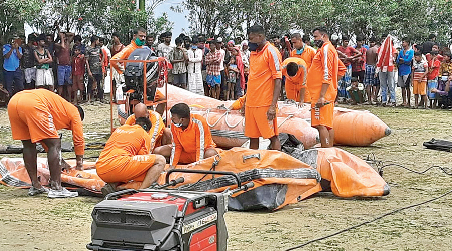 An NDRF rescue team in East Midnapore's Nandigram on Sunday near the site of the trawler capsize.
