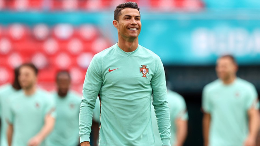 Cristiano Ronaldo smiles during the Portugal Training Session ahead of the Euro 2020 Group F match between Hungary and Portugal at Puskas Arena