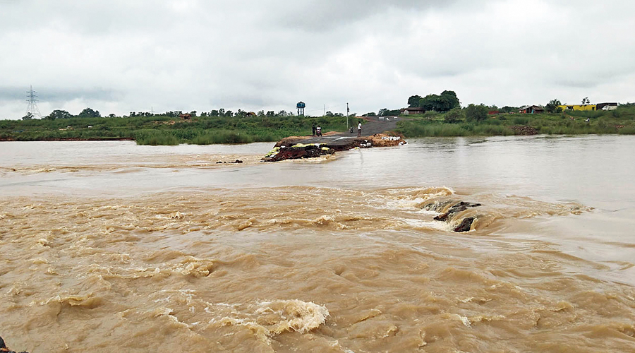 A submerged fair-weather bridge over the Ajay river in Joydeb, Birbhum district, on Wednesday. The bridge connects Birbhum with West Burdwan.