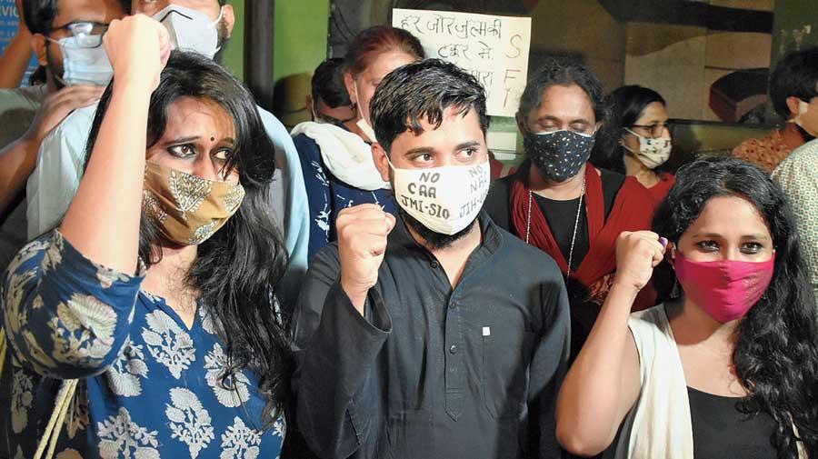 Natasha Narwal, Asif Iqbal Tanha and Devangana Kalita outside Tihar prison in New Delhi on Thursday.