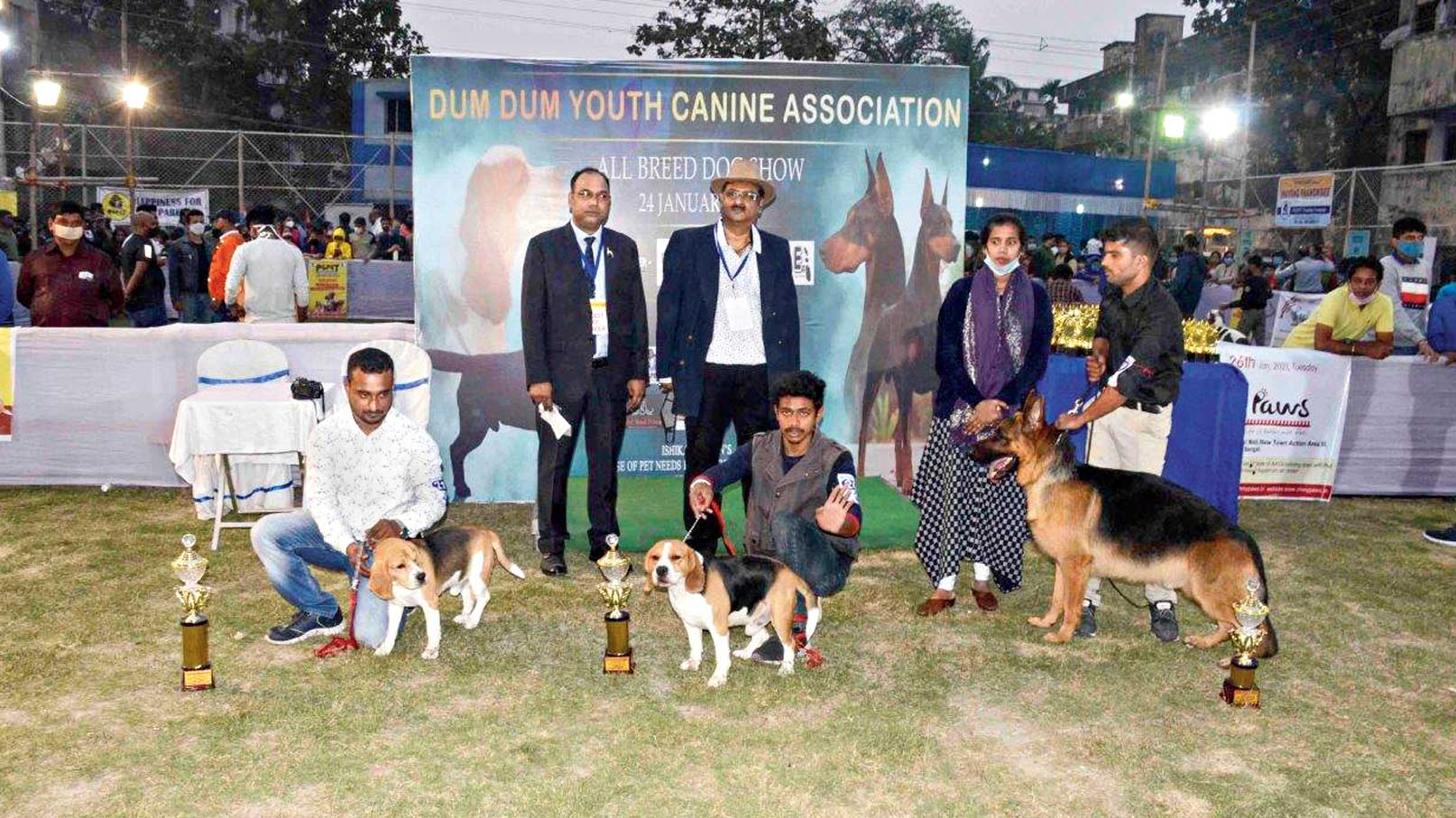 Dogs pose with their trophies at the Dum Dum show.
