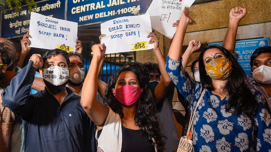 (From left to right) Asif Iqbal Tanha, Devangana Kalita and Natasha Narwal outside Tihar prison in New Delhi on Thursday evening.