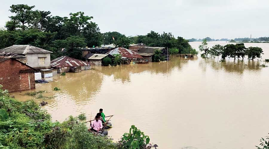 A locality flooded by the Dwarakeshwar river at Arambagh on Friday.