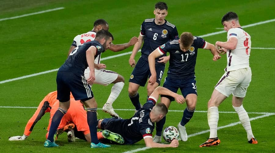 England and Scotland players scramble for the ball in their Euro cup match, at Wembley on Friday.