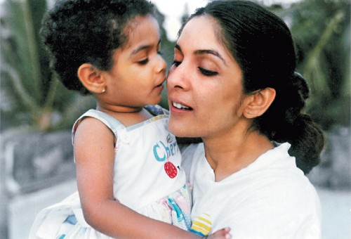 With a young Masaba