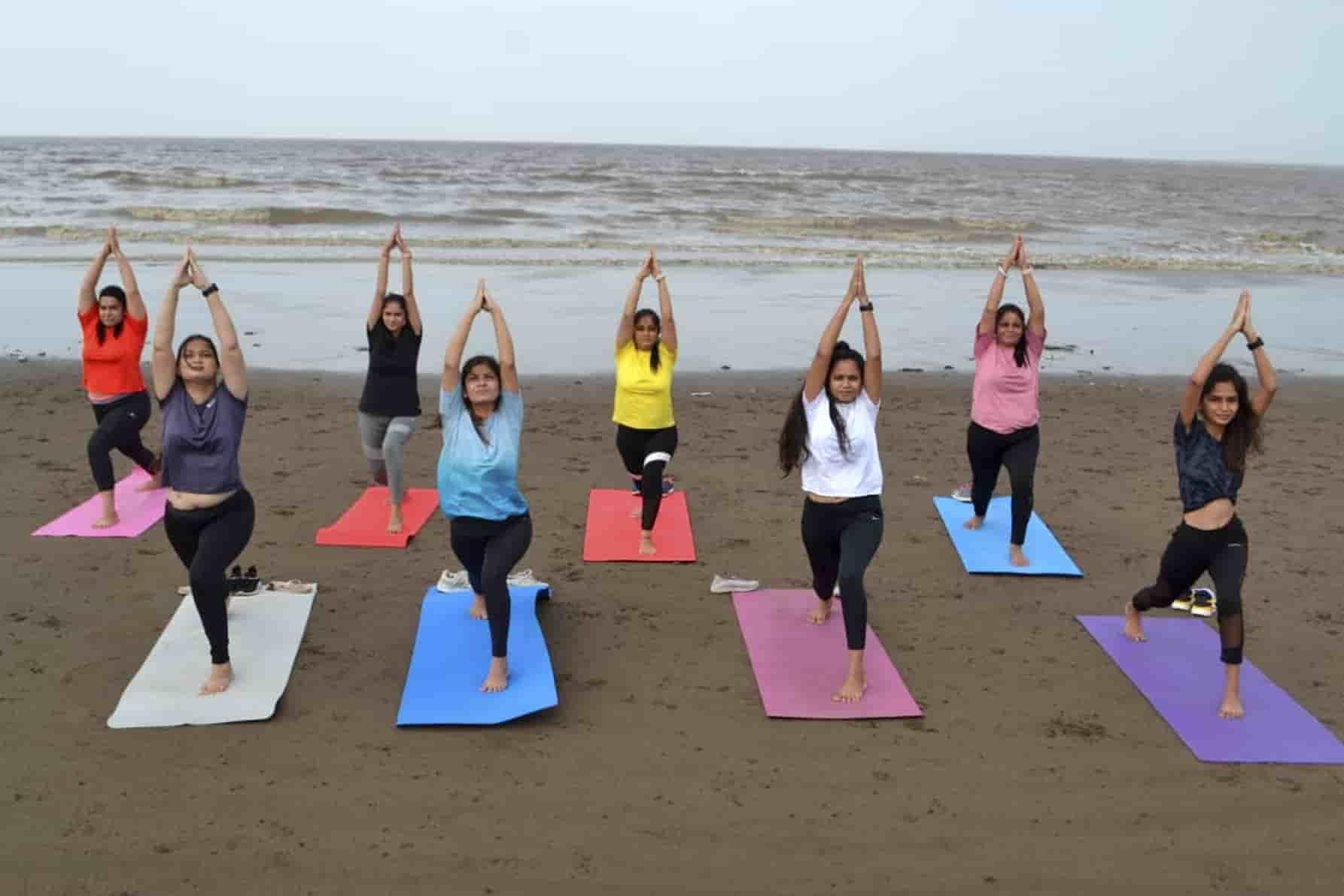 Surat women perform Yoga at a beach on Saturday.