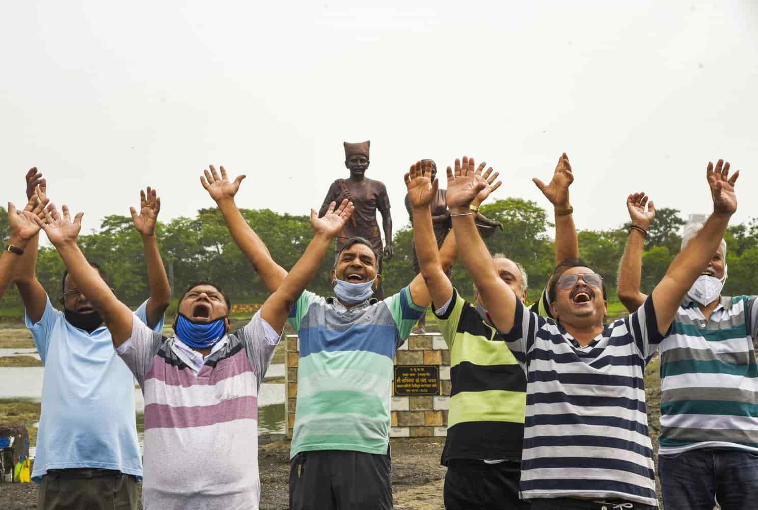 People perform Yoga at Mumbai's Mini Seashore on Saturday morning.