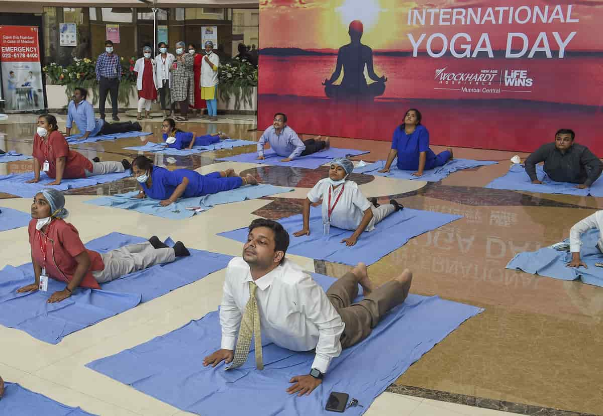 Doctors and other staff attend a Yoga session at a Mumbai hospital on Saturday.