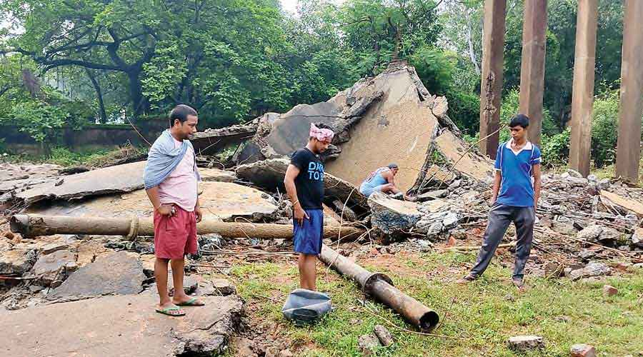 The debris of the collapsed reservoir in Andal, West Burdwan.