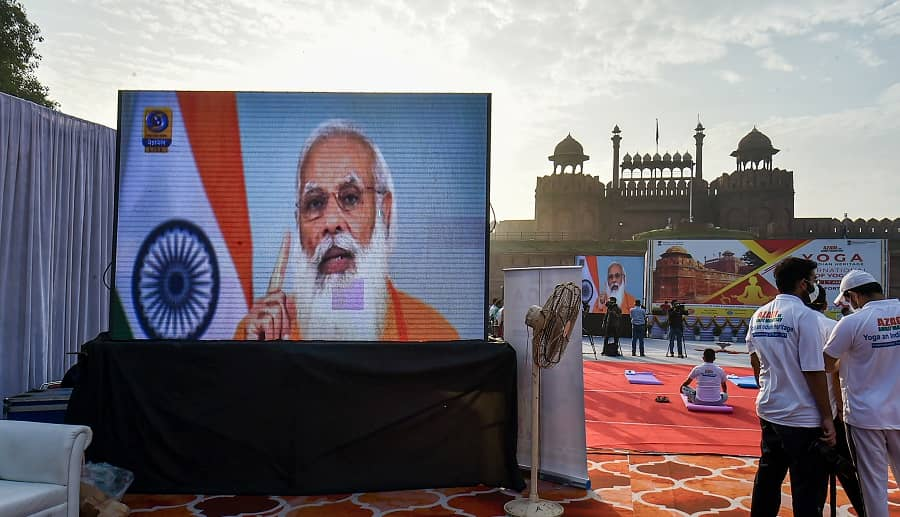 A screen shows Prime Minister Narendra Modis speech on International Day of Yoga at Red Fort in New Delhi on Monday.