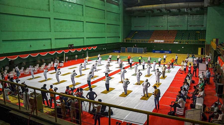 Assam Health Minister Keshab Mahanta along with others perform Yoga on International Day of Yoga, at Deshbhakta Tarun Ram Phookan Indoor Stadium in Guwahati on Monday.