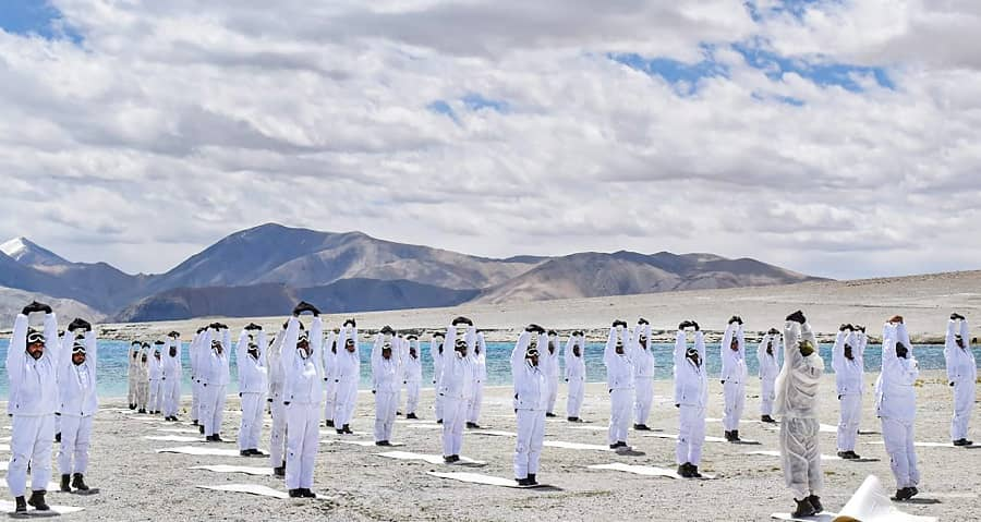 Indo-Tibetan Border Police (ITBP) performs Yoga on International Day of Yoga alongside Pangong Tso lake in Ladakh on Monday.