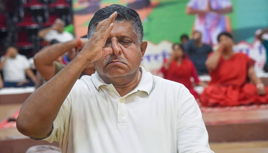 Union Law and IT Minister Ravi Shankar Prasad performs Yoga on the occasion of International Day of Yoga, in Patna on Monday.