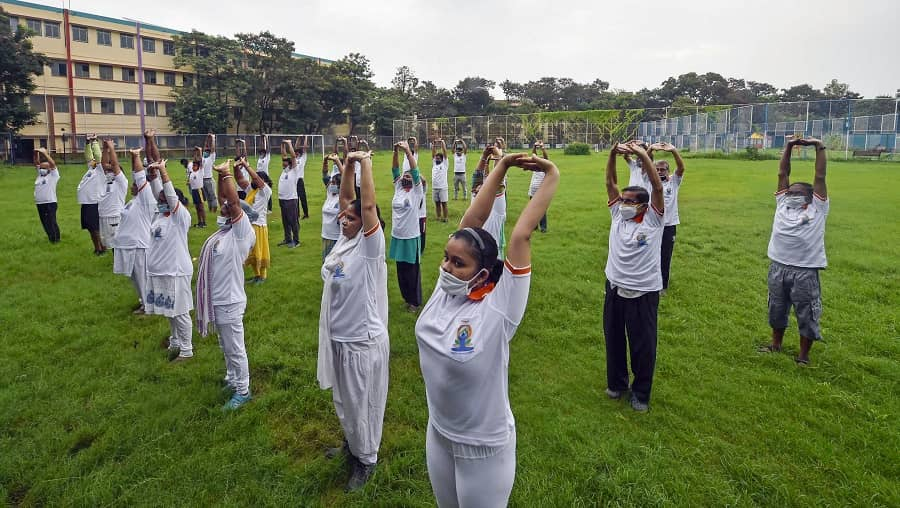People perform Yoga on the occasion of International Day of Yoga, in Calcutta on Monday.