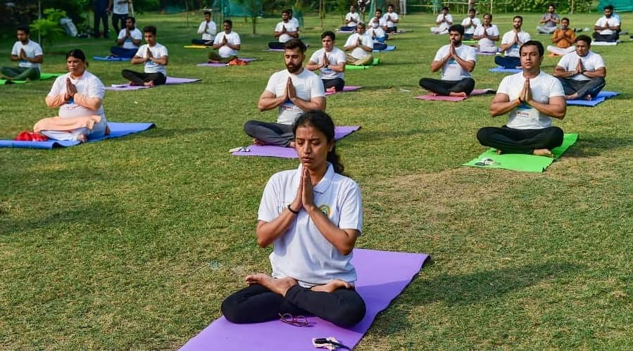 People perform Yoga on International Day of Yoga, in New Delhi.