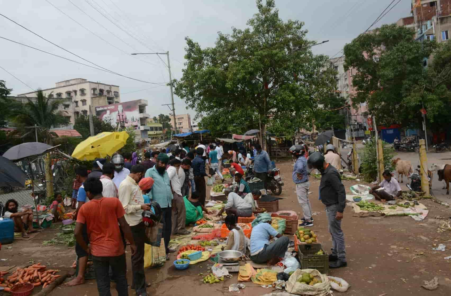 Vegetable vendors do brisk business on the median of Dimna Road near Blue Bells School in Jamshedpur on Tuesday.