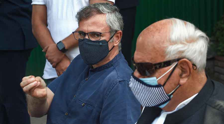 J&K National Conference President Farooq Abdullah and party Vice President Omar Abdullah talk to the media on their arrival from Delhi