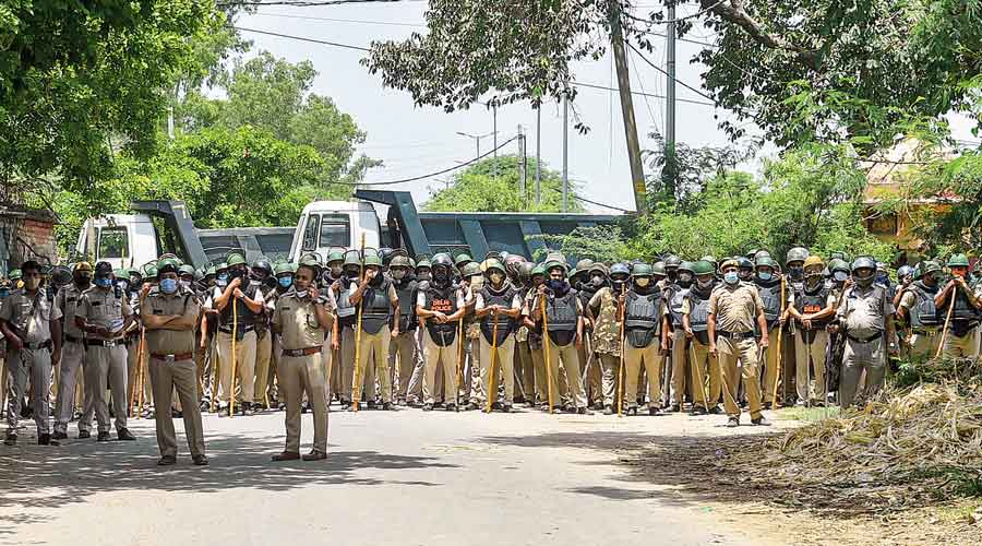Delhi police deployed at the Singhu border where farmers on Saturday marked seven months of their peaceful sit-in against the Centre's three farm laws