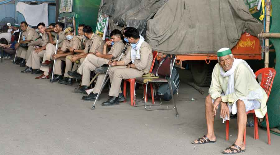 A farmer and security forces at the Ghazipur border near Delhi on Saturday