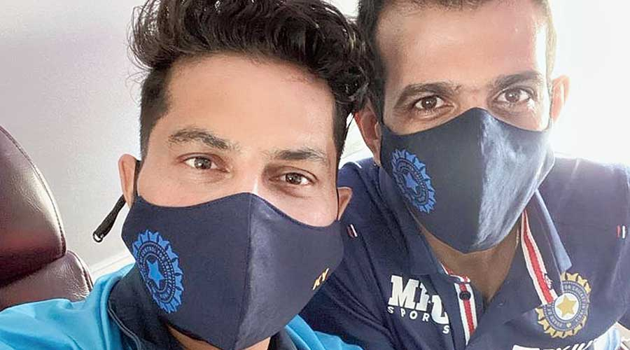 Kuldeep Yadav (left) and Yuzvendra Chahal on the flight to Colombo on Monday.