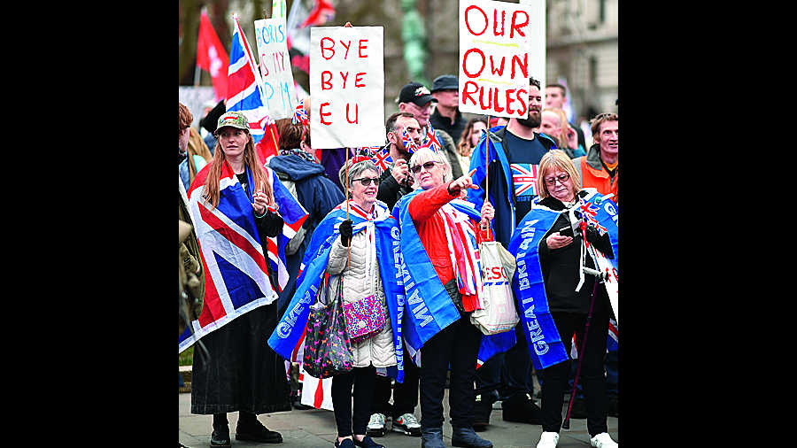 Pro Brexit supporters wave placards at Parliament Square as people prepare for Brexit on January 31, 2020 in London, United Kingdom. At 11.00pm on Friday 31st January the UK and Northern Ireland will exit the European Union 188 weeks after the referendum on June 23rd 2016.