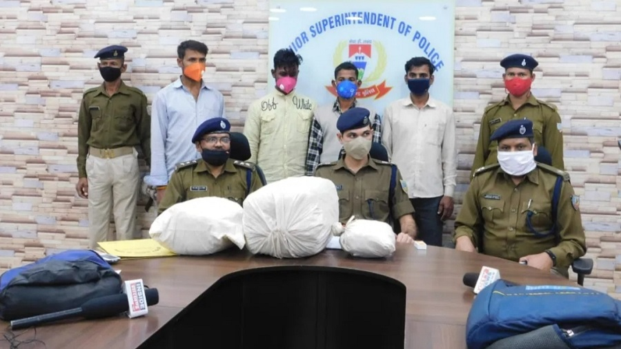 City SP, Subhash Chandra Jat (in the center) with the four arrested persons standing behind and the seized marijuana at the police office on Monday.
