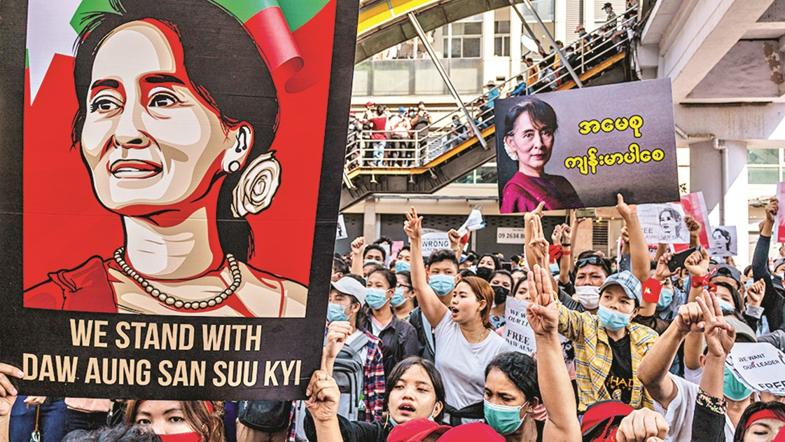 Protesters make three-finger salutes and hold up banners and posters as they march on February 08, 2021 in downtown Yangon, Myanmar. Tens of thousands of workers took to the streets in addition to protesters who had continued a campaign of civil disobedience over the last week. The movement represents the biggest challenge to the military junta, also known as the Tadmadaw, who on Feb. 1 staged a coup against the elected National League For Democracy (NLD) government and detained de-facto leader Aung San Suu Kyi, in more than a decade.