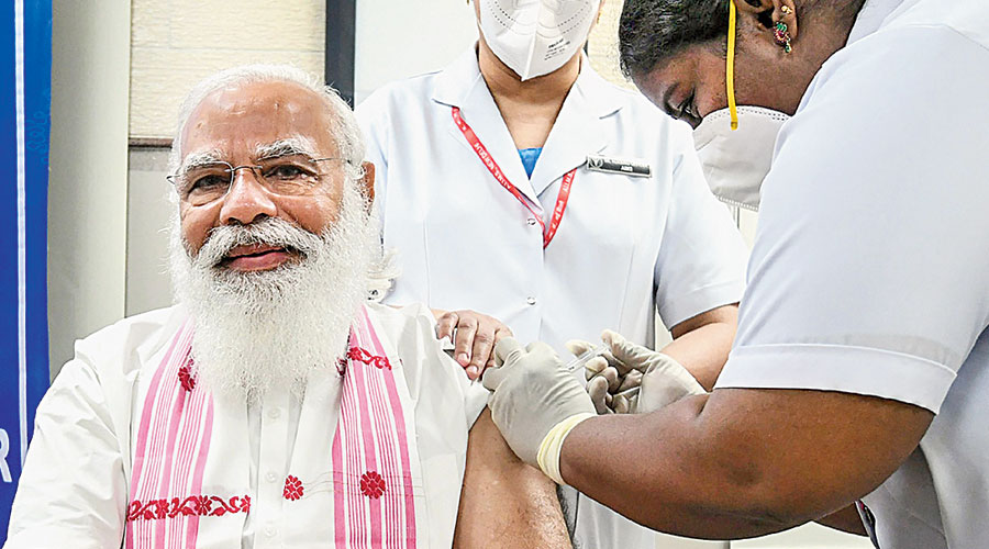 Modi takes his first dose of Covid vaccine at AIIMS in New Delhi on Monday.