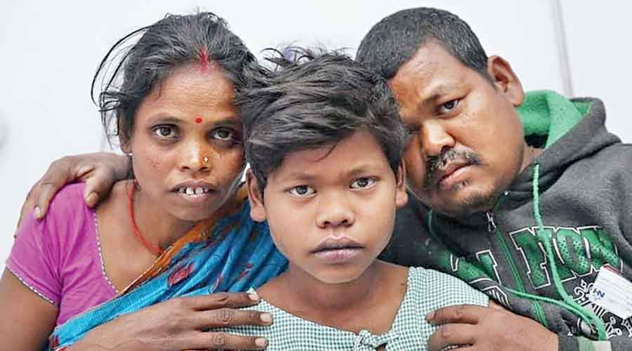 Badal Paida with his parents