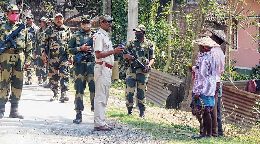 Paramilitary personnel interact with residents at Karimpur in Nadia district on Wednesday during a route march for confidence  building ahead of the Assembly polls.