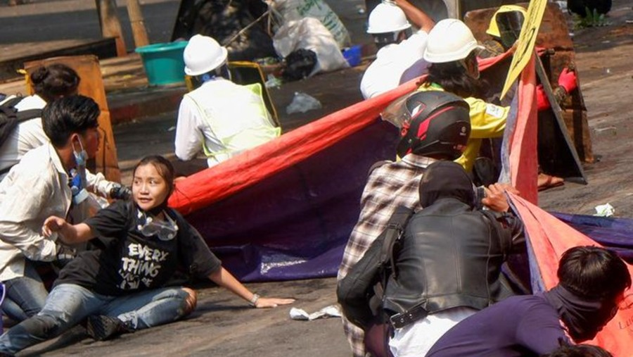 Angel, also known as Kyal Sin, takes cover as the police opened fire in Mandalay. She was killed by a shot to the head on Wednesday