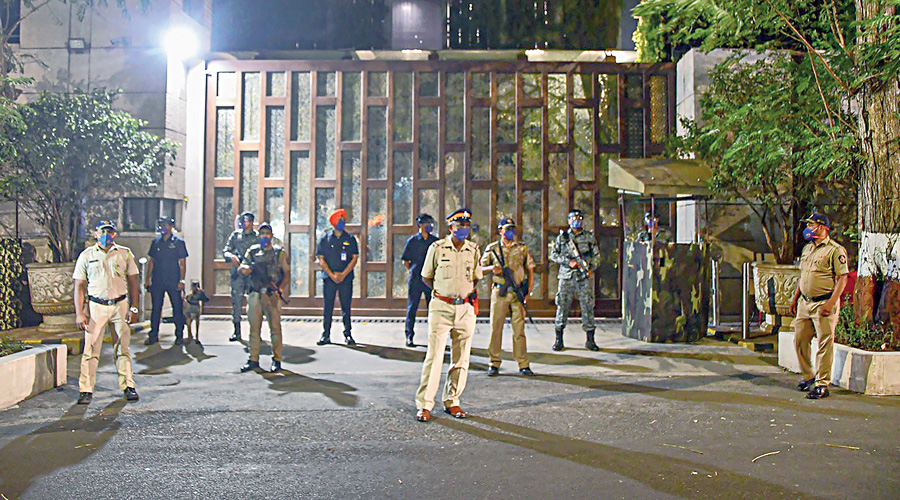 Police personnel stand guard outside Mukesh Ambani's residence in Mumbai on February 26, a day after the car  with explosives was found in its vicinity.