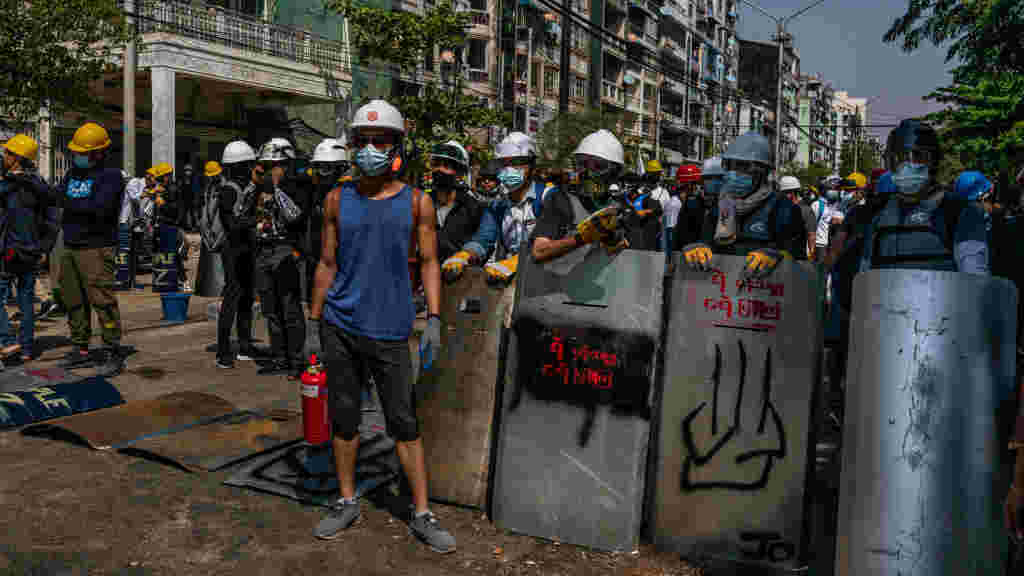 Anti-coup protesters block a street in preparation for clashes with military and police on March 05, 2021 in Yangon, Myanmar.